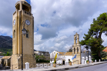 Archanes, Crete Island / Greece. The Venetian church of Virgin Mary (Panagia Kera or Faneromeni) is located near the entrance of the town of Archanes. Clock tower chimes every hour during the day