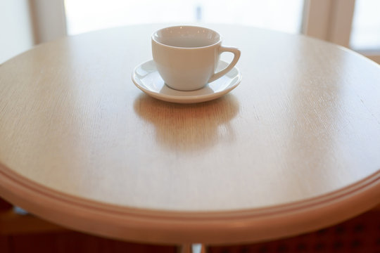wooden table white Cup and saucer side view