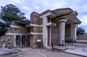 Knossos, Crete - Greece. The South Propylaeum at the archaeological site of Knossos which is the largest Bronze Age archaeological site on Crete and has been called Europe's oldest city. Cloudy sky