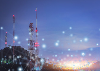 Telecommunications tower city at night .communication concept