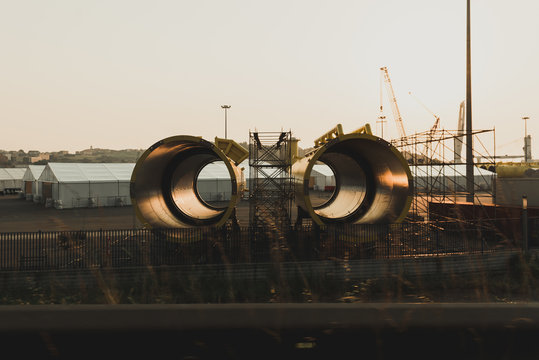 New big metal yellow pipe segments for oil locating on industrial ground