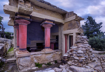 Knossos, Crete - Greece. The North Lustral Basin room at the archaeological site of knossos resembles a cistern. Its floor is lower than the surrounded area and is reached by steps. Sunset, cloudy sky