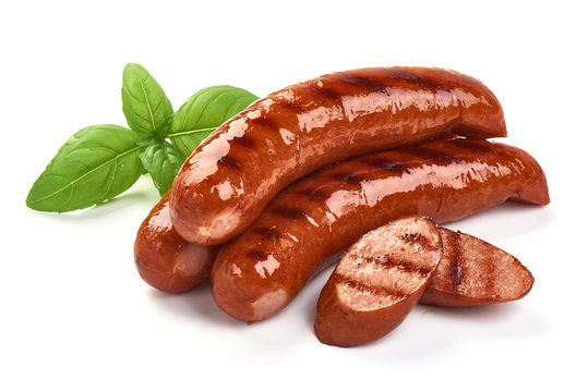 Grilled bratwurst Pork Sausages with basil leaves, close-up, isolated on white background