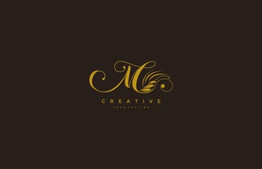 M letter luxury flourishes ornament logo