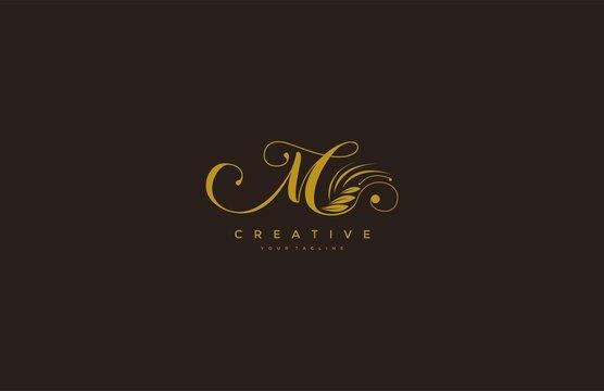 M letter luxury flourishes ornament logo