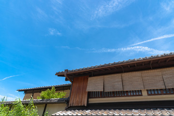 Street view of traditional architecture with blue sky in Kyoto, Japan