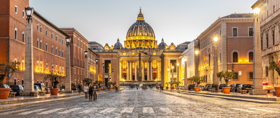 Vatican City by night. Illuminated dome of St Peters Basilica and St Peters Square at the end of Via della Conciliazione. Rome, Italy Wall mural