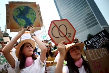 Demonstrators take part in the world march for climate change and the environment, called by the organization Fridays for Future at Angel de la Independencia monument in Mexico City
