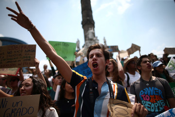 A demonstrator gestures in the world march for climate change and the environment, called by the organization Fridays for Future at Angel de la Independencia monument in Mexico City