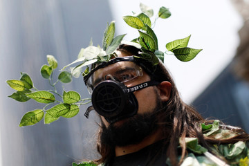 A demonstrator is seen in the world march for climate change and the environment, called by the organization Fridays for Future at Angel de la Independencia monument in Mexico City