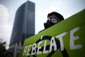 A demonstrator holds a sign in the world march for climate change and the environment, called by the organization Fridays for Future at Angel de la Independencia monument in Mexico City