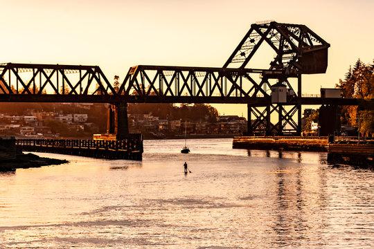 train bridge and paddleboarder at Ballard locks