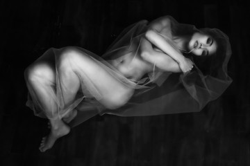 nude portrait of Asian model on wooden floor