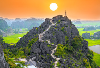 Ninh Binh, Vietnam - April 5th, 2019: Mua Cave mountain viewpoint, Stunning view of Tam Coc area with mountain range, rice fields. It is such as Great Wall in Ninh Binh, Vietnam