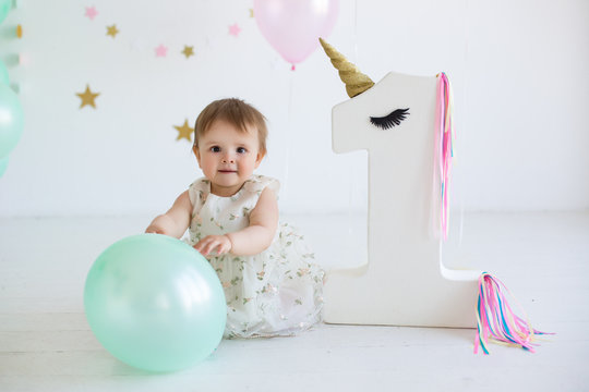 Cute baby girl portrait at birthday party
