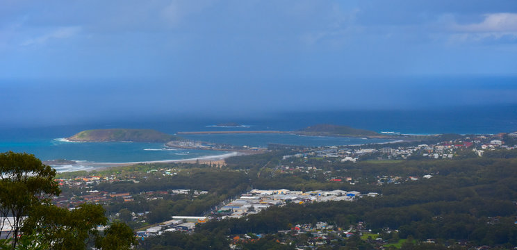 View of Coffs Harbour from Forest Sky Pier, which is a lookout pier with sweeping views on a cloudy day.