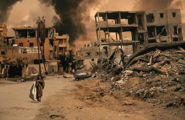 Homeless little girl walking in destroyed city that was bombed by the enemy and she's looking for shelter.