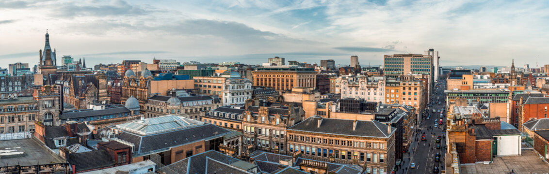 A wide panoramic looking out over old and new buildings and streets in Glasgow city centre. Scotland, United Kingdom