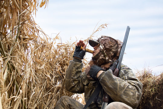 hunter sits in the shelter and lures the ducks