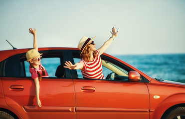 happy family mother and child girl goes to summer travel trip in car.