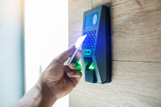 Door access control. Staff holding a key card to lock and unlock door at home or condominium.