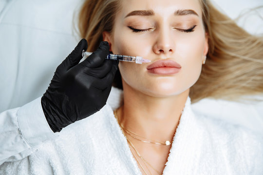 Injections of the lips. Correction form the upper lip. Injection of beauty. Spa. Facial Rejuvenation.