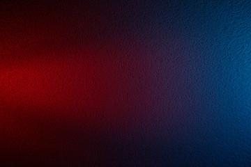 Red cone-shaped beam of light on a dark red and blue background