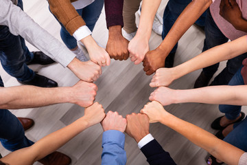 People Hands Joining Their Fist To Form Circle