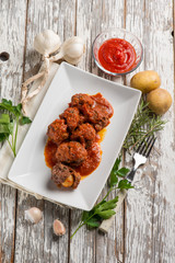 meatball with tomatoes sauce filled with potatoes