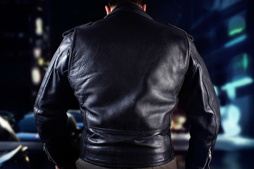 Biker man in leather jacket closeup photo.