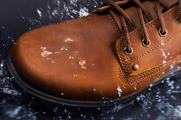 Brown leather boots water splash.