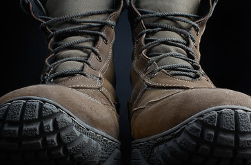 Photo of a pair of military boots front view.