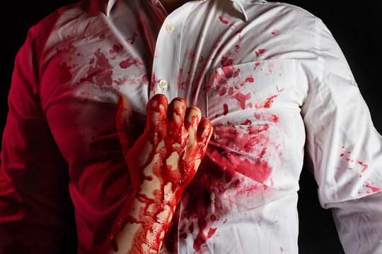 Murderer in white bloody shirt with victim.
