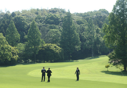 Security agents stand on the green ahead of a game of golf between U.S. President Donald Trump and Japan's Prime Minister Shinzo Abe at Mobara Country Club in Mobara