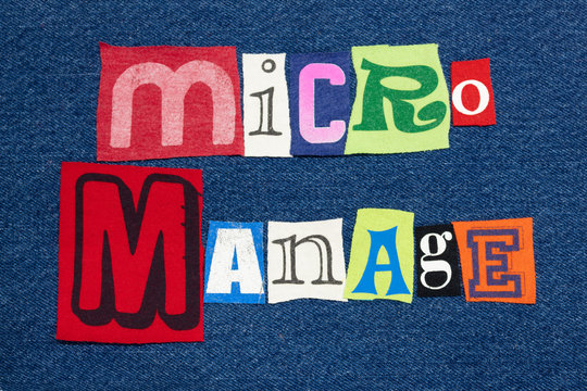MICROMANAGE text word collage colorful fabric on denim, leadership style, horizontal aspect
