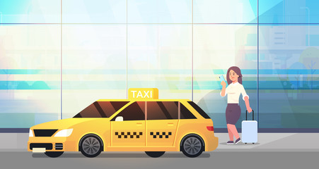 businesswoman using mobile app ordering taxi on street business woman in formal wear with luggage near yellow cab city transportation service concept full length flat horizontal