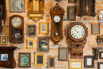 Collection of vintage clock hanging on an brick wall