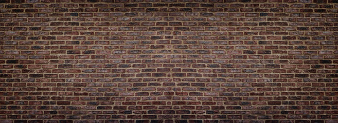 Wide red shabby brick wall texture. Old masonry panorama. Dark rough brickwork panoramic background