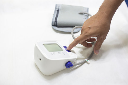 Woman checking accuracy blood pressure monitor,concept:Health care and Medical,Doctor Measuring  patient arterial