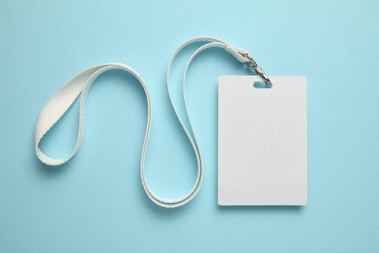 Name tag, badge mockup. Lanyard card blank on blue background.