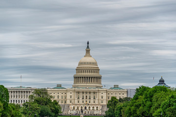 Wall Mural - Washington DC Capitol from the mall on cloudy sky background