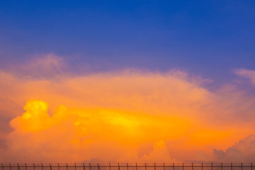 orange and blue sky with small fence on base of picture and the image can use for commercial background.