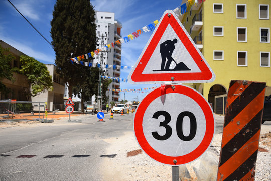 Roadwork and speed limit traffic signs in Yehud - small city in central Israel.