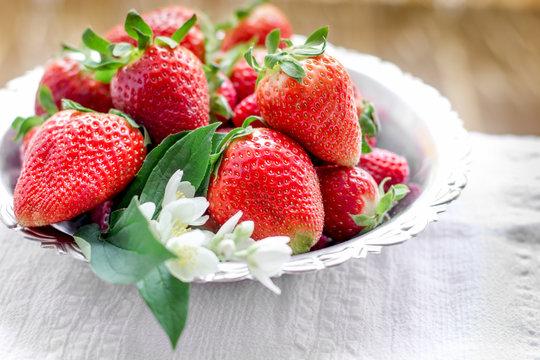 Srtawberry, fresh organic strawberies nd flower jasmine