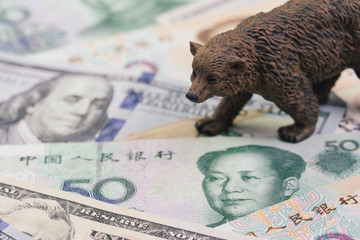 US and China trade war and tariff impact to bear market, price drop in stock concept, bear figure walking on pile of United States and Chinese banknotes, world most financial influence countries