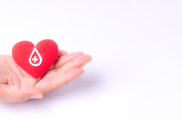 Woman hands holding red heart for blood donation,world blood donor day. Copy space for advertisers.