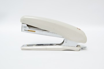 Stapler isolated on white background. Top view close up details.