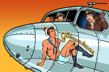 women pilots girls. Pinup man on the fuselage of a retro bomber