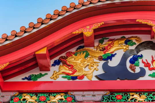 Shuri Castle's karahafu style red tiled roof decorated with dragons in the Shuri neighborhood of Naha, the capital of Okinawa Prefecture, Japan.