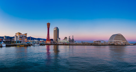 Wall Mural - Port of Kobe city skyline before sunset in Kansai, Japan - Panorama